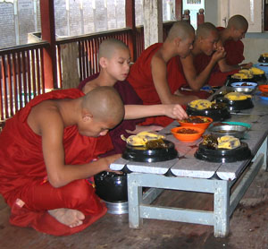 Young monks eating at monastery in Myanmar (Burma)
